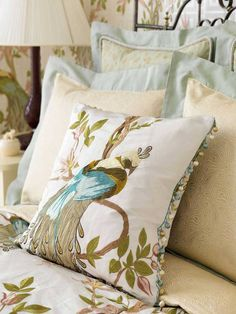 A fantastical bird of paradise cushion by Nina Campbell Paradiso.