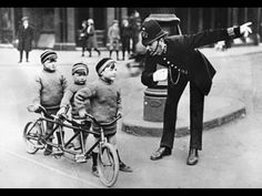 . Which way mister ? Whimsical real life vintage photo need to know where the tricycle race is ask a policeman