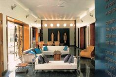 Contemporary style living room space with fabricated sitting elements having cushions and black marble floor with glisters .