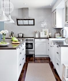 IKEA kitchen Get the look: Modern country Classic Shaker-style kitchen cabinetry. Sleek dark grey quartz countertops. Country elements, such as an apron-front sink, used sparingly. Crisp white finishes mixed with warm greys. Modern accents like bold cabinetry hardware and industrial-style pendant lights.