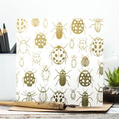 Illustrated gift card featuring 'I Like Big Bugs' pattern design in soft ochres and greens. By Jessica Wilde Designs 2016 ©