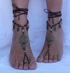 "Brass and Brown Filigree "" Heart of Viana"" Barefoot Sandals - Foot Jewelry - Toe Anklet Beaded Crochet Hippie Sandals. Beautiful and unique barefoot sandals with a portuguese vibration. They look great as a necklace or you can use it as a slave bracelet. Handmade crochet with love and care using waxed polyester cord, antique bronze beads, brass filigree heart of viana, brass filigree leaf charms and glass beads. The lace is long enough to wrap it 2 times around the leg. These sandals are..."