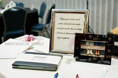 Wedding reception idea for interactive guests at the entry table. Advice for the bride and groom written by guests on scrapbook paper to place into a wedding day scrap book.