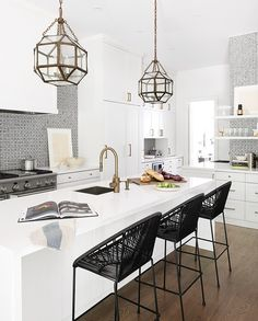Pretty Lanterns Functional pendants such as schoolhouse or globe lights are easy to clean and suit the industrial trend that's been gaining momentum. But there's something to be said about a jewel-like fixture, such as these faceted lanterns, that make a kitchen feel special.