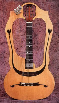 Harp Guitar by LUIGI MOZZANI. #music #instruments http://www.pinterest.com/TheHitman14/music-instruments/