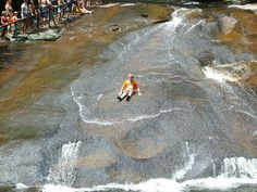 Sliding Rock, NC. Did that last spring. Hey if a couple of 15 year old boys can do it, so can I.