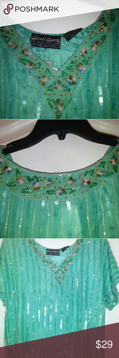 Vintage Jewel Queen Sequin Blouse Teal Size S Vintage JEWEL QUEEN SEQUIN BLOUSE 100% Silk TEAL* FLORAL SEQUIN AT NECK* NWT *Size S. CRUISE OR HOLIDAY WARE SHELL 100% SILK * SLIT ON SIDES * SHORT SLEEVE LINED *V-NECK *EXTRA SEQUIN?  IF YOU HAVE QUESTIONS EMAIL ME Jewel Queen Tops Blouses