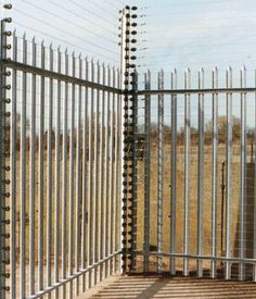 Electric fencing looking at the corner section with electric fence post and insulators. Electric Fence Posts, Electric Fencing, Security Fencing, Perimeter Security, Wildlife Park, Fence Gate, Corner, Yard, Gallery
