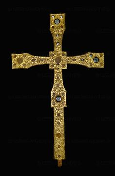 Anglo-Saxon work,perhaps from Northumbria,between 700 and 750.Wooden core,sheetgold and glasspaste.Golden arabesques in vineform,animals.The cross may have been ordered for Salzburg by Irish bishop Virgil and used during the consecration of the cathedral in 744.H:158  Cathedral and Museum, Salzburg, Austria
