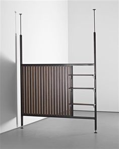 JEAN PROUVÉ with CHARLOTTE PERRIAND 'Afrique' room divider, from the Air France building, Brazzaville, Congo, c. 1952  Painted bent steel, mahogany. 296 x 203 x 22.5 cm. (116 1/2 x 79 7/8 x 8 7/8 in.) fully extended Manufactured by Les Ateliers Jean Prouvé, France.