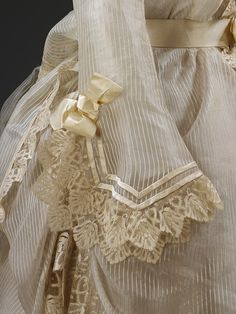 I am awed when I see detailing on dresses such as this one. Those ribbons of trim were sewn on by hand and they are all over the dress. No pre-printed designs here.
