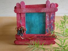 popsicle stick photo frame - embellish with acorns or leaves?? cute.