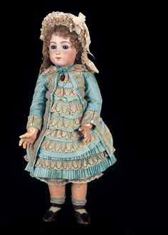 Outstanding French Bisque Bebe Triste by Emile Jumeau in Superb Original Costume and Box Price Realized: $48,000