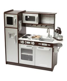 Young chefs serve the best dishes from this interactive play kitchen and baking set. Featuring an easily cleaned removable sink, appliances with knobs that turn and click and doors that open and close, this kitchen invites multiple children to cook together in an exciting and educational environment. Plus, the moving mixer and baking utensils allow little ones to make two play cookies.