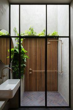 Indoor/Outdoor bathroom design with wood paneling and brass shower fixture House Design, Outdoor Bathrooms, Bathroom Interior, House Interior, Industrial Interiors, Indoor Outdoor Bathroom, Bathroom Design, Beautiful Bathrooms, Brick Flooring