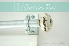 Electrical conduit and a pair of chippy old door knobs will get you a custom curtain rod that'll knock yer socks off. I think I'd give the rod some paint and a little tough love to match the knobs........D.