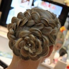 This is such a cool hair style.  It looks exactly like a flower.  Plus I love the rhinestone in the middle.  It just adds a little more sparkle.