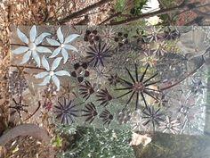 Glass on glass mosaic window.