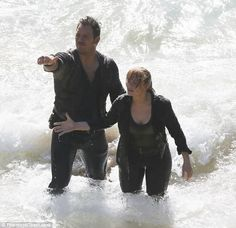 Chris Pratt and Bryce Dallas Howard struggle through the surf as they film Jurassic World: Fallen Kingdom in Hawaii