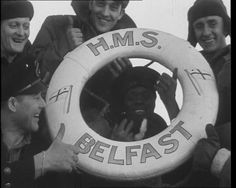 Crew members pose with an HMS Belfast lifebuoy in this 1940s footage: http://www.britishpathe.com/video/royal-navy-ships-2