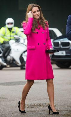 Catherine, Duchess of Cambridge who is due to give birth late next month, looked radiant in a fuschia-pink Mulberry coat which she accessorized with a Mulberry purse and her favorite black heels