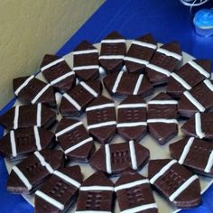 Football brownies! Used for sports themed baby shower but this is great for Super Bowl parties!! These can easily be homemade as well
