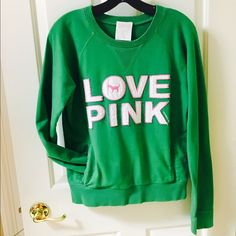 "VS PINK Crewneck Sweatshirt VS PINK - amazing Kelley green colored sweatshirt. Similar to a collegiate style crewneck. Has two front pockets like a hoody. Large ""86"" patchwork stitched on back. ""Love Pink"" on front. Size M. Victoria's Secret Tops Sweatshirts & Hoodies"