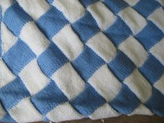 Blue and white entrelac blanket for a little boy this one has a different border