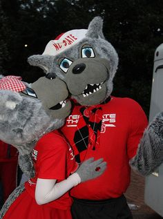 Mr. & Mrs. Wuf sharing a quick kiss during the 2009 Homecoming Parade.