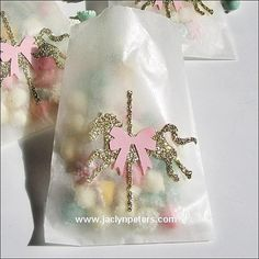 Our handmade gold glitter carousel horse candy bags are simply sweet with their pink bow saddle! Fill with candy, confetti or baked goods to thank your party gu