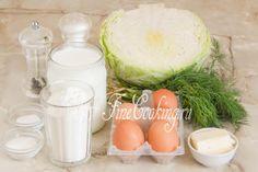 Шаг 1. В рецепт приготовления этой простой и вкусной домашней выпечки входят следующие ингредиенты: пшеничная мука, кефир (любой жирности), яйца куриные, белокочанная капуста, свежий укроп, сливочное масло, соль, сахар, пищевая сода и молотый черный перец