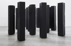 Yang Mushi, 'Cutting in – Pillar', 2015, solid elm wood board, black spray lacquer ,17 pieces, 173 x ø 50 cm each. Image courtesy the artist and Galerie Urs Meile, Beijing-Lucerne.  Full article: http://artradarjournal.com/2016/10/04/chinese-artist-yang-mushi-interview/