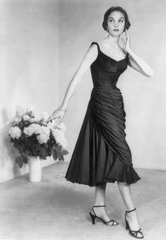 Fall 1954 season.  Cocktail dress of French silk chiffon jersey  designed for Samuel Winston by Roxanne