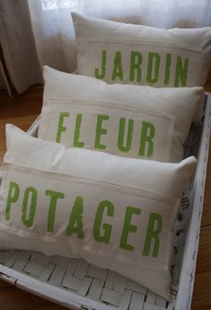 Another one. Gotta order some of these!    Made of unbleached muslin, with green apple-colored French words (potager = vegetable, fleur = flower, jardin = garden). They would look wonderful in an old box (as pictured), tossed in a basket or placed on a wicker chair. Great even as a gift...send these instead of a bouquet de fleurs.
