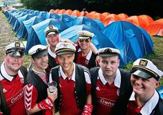 JokestersDenmark supporters, dressed up as Danish comedian Stewart Stardust, stand at the Danish tent camp ahead of their country's Euro 2012 match against Portugal. The Danes wouldn't be laughing in the end, falling 3-2 to a relentless Portuguese side.