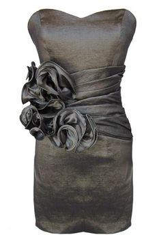 Metallic Bloom Dress: Features a chic strapless cut teamed with a charming sweetheart neckline, flattering princess seams to the bodice, dramatic corsage display comprised of rich ruffled detailing at right waist, and an iridescent charcoal hue to finish.