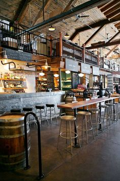 Love this concrete floor for the main floor receiving area. The tin bar is cool. Use same idea for a small reception desk