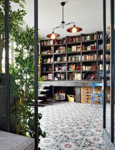 I love the tiles and the style of the book shelf. i also like the lights and i think it looks really nice with the plants. i dont like the floor boards. i think its cool how there are stairs that lead up to the book shelf.