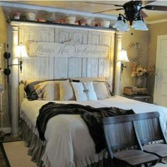 HEADBOARD, made using old salvaged doors and porch columns. Absolutely love this idea.
