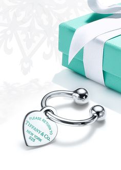 A holiday rooted in tradition. When the Return to Tiffany® key ring was first introduced in 1969, every one sold was assigned a registration number, ensuring that if the owner and keys were ever separated, they would be reunited at Tiffany.