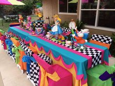 What could be more fun than an Alice in Wonderland party? The colors, the characters, Alice has it all! For my daughter's first birthday party we invited our guests to ONEderland and it turne… Alice In Wonderland Tea Party Birthday, Alice Tea Party, Wonderland Party, Winter Wonderland, Alice In Wonderland Decorations, Alice In Wonderland Cakes, Alice In Wonderland Invitations, Alice In Wonderland Characters, Party Mottos