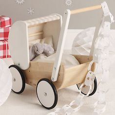 Buy The Little White Company > Toys > Wooden Pram from The White Company