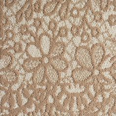 This modern floral print adds a hip, feminine feel to your area rug, and is a piece of cake to clean.