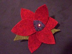 Soft circuit - LED flower pin by Shannon Henry, via Flickr