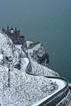 Lighthouse in Snow, Llandudno, Wales, United Kingdom (by AdarglasPhotos on…