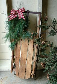 Great idea...I love old wooden sleds!