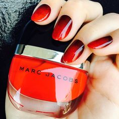<p><strong>Step 1:</strong> Paint your nails with two coats of your deep red polish and allow a few minutes to dry.</p> <p><strong>Step 2:</strong> Apply a swab of your bright red polish onto your makeup sponge, and then gently dab on the color starting at the tip of your nail to about halfway down the nail. Repeat this step until the bright red is vibrant at the tip of your nail, but seamlessly fades into the deeper red color.</p> <p><strong>Step 3:</strong> Apply top coat to smooth out any…