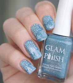 White snowflakes stamped on holographic blue