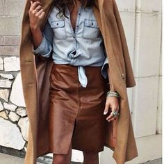 Brown leatherette skirt with front slit worn with light blue chambray button down and camel coat. Fashion Mode, Work Fashion, Fashion Outfits, Womens Fashion, Trendy Outfits, Fashion Clothes, Skirt Outfits, Winter Outfits, Brown Leather Skirt
