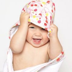 Bebe au Lait Lille Hooded Towel. A hooded baby towel is a great way to keep baby warm after bath! Choose boy or girl fishes design. #baby #towel #bath